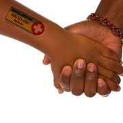Two-line water applied safety tattoo on dark skin