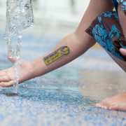Example of one-line water applied safety tattoo